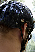 Rear view of a male mountain biker wearing a helmet, close-up