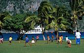 Children of the Ratu Namasi school on Yasawa Island playing football, Yasawa group, Fiji, South Sea