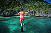 Woman jumping into the water, Snorkeling, Sawa-I-Lau and the Blue Lagoon, Yasawa group, Yasawa group, Fiji, South Sea