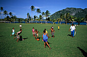 Children of the Ratu Namasi school playing football on Yasawa Island, Yasawa group, Fiji, South Sea