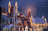 Amusement park in the evening light, Luna Park in North Sydney, Sydney, New South Wales, Australia