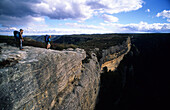 Two hikers on top of Kanangra Walls, Kanangra Boyd National Park, New South Wales, Australia
