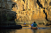 Tourists in canoes in the 5th gorge of the Katherine River in Nitmiluk National Park, Northern Territory, Australia