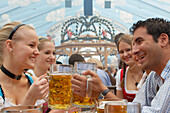 Young people having fun during the Oktoberfest, Munich, Bavaria, Germany