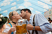 Young couple kissing during Oktoberfest, Munich, Bavaria, Germany
