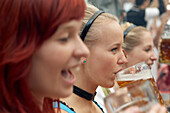Three young women having fun during the Oktoberfest, Munich, Bavaria, Germany