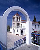 Archway and church. Kalandra. Chalkidiki. Greece