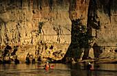 People Kayaking on the Fitzroy River in the Geikie Gorge, Geikie Gorge National Park, Western Australia, Australia