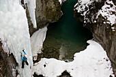 Man ice climbing in a gorge, Pontresina, Upper Engadin, Grisons, Switzerland