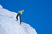 Teenager abseiling from Corn Diavolezza (man-made icefall), Pontresina, Upper Engadin, Grisons, Switzerland
