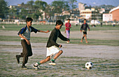 Playing soccer. Katmandu. Katmandu valley. Nepal