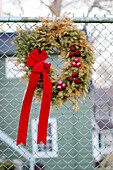 Bow, Celebrate, Celebrating, Celebration, Celebrations, Chainlink fence, Chainlink fences, Christma baubles, Christmas, Christmas bauble, Christmas bow, Christmas decoration, Christmas decorations, Christmas ornament, Christmas ornaments, Close up, Close