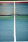 Alone, Color, Colour, Concept, Concepts, Daytime, Detail, Details, Divided, Division, Exterior, Line, Lines, Middle, Net, Nets, Obstacle, Obstacles, Outdoor, Outdoors, Outside, Separate, Separation, Sport, Sports, Tennis, Tennis court, Tennis Court, Tenn