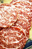 Aliment, Aliments, Background, Backgrounds, Close up, Close-up, Closeup, Cold cuts, Color, Colour, Deli, Deli meats, Detail, Details, Food, Genoa salami, Indoor, Indoors, Inside, Interior, Italian salami, Lunch, Lunch meats, Nourishment, Salami, Sausage,