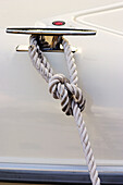 Anchor line, Boat, Boats, Cleat, Close up, Close-up, Closeup, Color, Colour, Concept, Concepts, Daytime, Detail, Details, Dock, Dock line, Docked, Exterior, Marina, Metal, Nylon, One, Outdoor, Outdoors, Outside, Rope, Ropes, Safety, Security, Stainless s