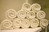 Clean, Close up, Close-up, Closeup, Color, Colour, Concept, Concepts, Design, Gym, Gym towels, Heap, Heaps, Horizontal, Hotel spa, Household linen, Hygiene, Indoor, Indoors, Inside, Interior, Linen, Pile, Piles, Relax, Relaxation, Relaxing, Rolled, Rolle
