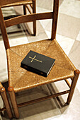 Bible, Bibles, Chair, Chairs, Christian, Christianity, Church, Churches, Color, Colour, Concept, Concepts, Cross, Crosses, Detail, Details, Faith, Good book, Holy, Holy Bible, Holy book, Holy books, Indoor, Indoors, Inside, Interior, Object, Objects, One