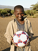 African child with ball, Tanzania