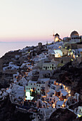 Architecture, Coastal Town, Coastal Towns, Color, Colour, Cyclades, Europe, Exterior, Greece, Illuminated, Illumination, Island, Islands, Lights, Oia, Oía, Outdoor, Outdoors, Outside, Overview, Overviews, Santorin, Santorini, Sunset, Sunsets, Thera, Thir