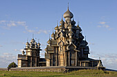 Church of the Intercession of the Mother of God, Pokrovskaia Tserkov, 1764. Church of Transfiguration, Preobrajenskaia Tserkov, 1714. Tower clock, 1874. Kizhi Island. Onega lake, Karelia. Russia.