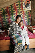 Mother and child, both HIV positive, at home in Addis Ababa, Ethiopia