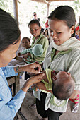 Baby receiving an immunisation shot, at a rural health centre in Kampong Thom. Cambodia