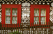 Wood cottages painted with embroidery motifs in Cicmany Village. Central Slovakia