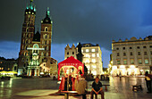 St Mary s Church and toy vendor s stall. Rynek Glowny. Krakow s town square. Poland