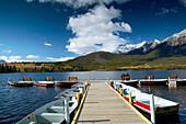 Rental boats at Pyramid Lake and Pyramid Mountain (2762 m) in background. Jasper National Park. Alberta, Canada