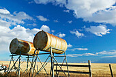 Oil tanks, landscape with dramatic sky. Stand Off. Alberta, Canada