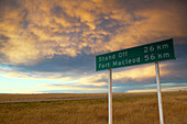 Road sign (Rt. 2), landscape with dramatic sky. Cardston. Alberta, Canada