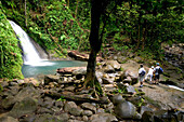 French West Indies (FWI), Guadeloupe, Basse-Terre, Route de la Traversee: Parc Nationale de la Guadeloupe: Cascade aux Ecrevisses Waterfall. with Visitors