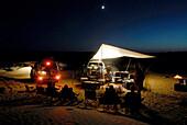 A group of people camping in the desert, Offroad 4x4 Sahara Desert Tour, Bebel Tembain area, Sahara, Tunisia, Africa, mr