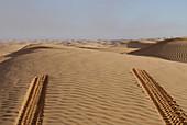 Car tracks in the sand, Offroad 4x4 Sahara Desert Tour, Bebel Tembain area, Sahara, Tunisia, Africa