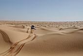 4x4 vehicle, jeep driving over sand dunes in the desert, Offroad 4x4 Sahara Desert Tour, Bebel Tembain area, Sahara, Tunisia, Africa, mr