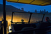 On a safari tour at night, Jeep, Wild animals in the background, South Africa, Africa