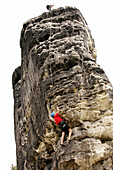 Two people climbing a rock face, Elbsandsteingebirge, Elbe Sandstone Mountains near Rathen, Saxony, Germany, mr