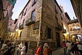 Barcelona,Barri Gotic Carrer del Bisbe at twilight people