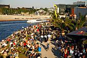 Berlin capital beach near Lehrter main station, riverbank Spree , Tour boat people