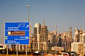 Dubai Marina skyscrapers under construction,highway