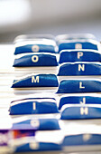 Alphabet, Arrangement, Blue, Business, Card, Character, Characters, Choice, Choose, Choosing, Close up, Close-up, Closeup, Color, Colour, Concept, Concepts, Contemporary, Desk, Detail, Details, Election, File, File cards, Files, Indoor, Indoors, Interior