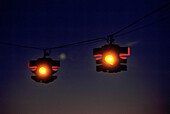 Amber light, Color, Colour, Exterior, Hang, Hanging, Horizontal, Lights, Night, Nighttime, Outdoor, Outdoors, Outside, Pair, Signal, Signals, Traffic, Traffic lights, Traffic signal, Traffic signals, Two, CatV5, 13366, agefotostock