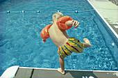 Back view, Balance, Bathing suit, Bathing suits, Boy, Boys, Caucasian, Caucasians, Child, Childhood, Children, Color, Colour, Contemporary, Equilibrium, Exterior, Holiday, Holidays, Horizontal, Human, Infantile, Kid, Kids, Leisure, Male, Motion, Movement