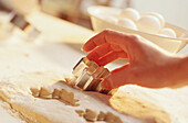 Action, Activity, Biscuit cutter, Close up, Close-up, Closeup, Color, Colour, Cook, Cookie, Cookies, Cooking, Cuisine, Cutter, Cutters, Detail, Details, Dough, Egg, Eggs, Female, Hand, Hands, Horizontal, Indoor, Indoors, Ingredient, Ingredients, Interior