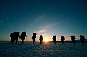 Adult, Adults, Adventure sports, Back view, Backpack, Backpacks, Cold, Coldness, Color, Colour, Contemporary, Desolate, Desolation, Determination, Effort, Efforts, Endurance, Exterior, Group, Groups, Hike, Hiking, Horizontal, Human, Ice, Outdoor, Outdoor