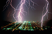 Anger, Bolt, Bolts, Cities, City, Color, Colour, Danger, Electric power, Electricity, Energy, Exterior, Hazard, Horizontal, Light, Lightning, Meteorology, Natural phenomena, Natural phenomenon, Nature, Night, Nighttime, Outdoor, Outdoors, Outside, Power,