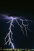 Anger, Bolt, Bolts, Cities, City, Cloud, Clouds, Color, Colour, Danger, Electric power, Electricity, Energy, Exterior, Hazard, Light, Lightning, Meteorology, Natural phenomena, Natural phenomenon, Nature, Night, Nighttime, Outdoor, Outdoors, Outside, Powe