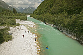 Turquoise Waters of the Soca River. Julian Alps with Kayakers. Soca. Primorska. Slovenia.