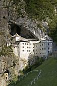 XVIth century Predjama Castle perched atop a 123 meter cliff. Predjama Castle. Notranjska. Slovenia.
