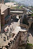 Meherangarh Fort. Visitors climbing up to fort. Jodhpur. Rajasthan. India.